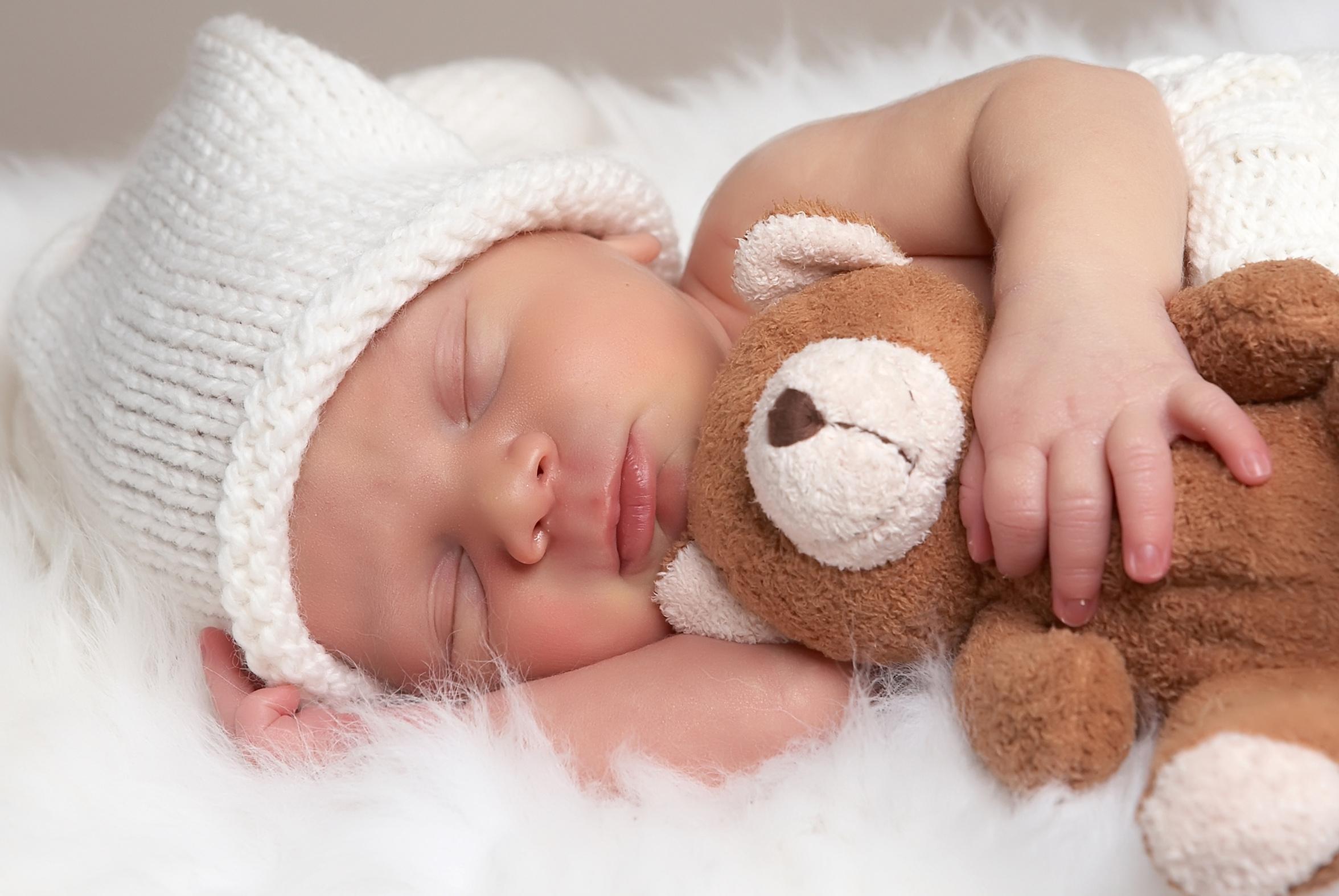 sleeping baby and teddy