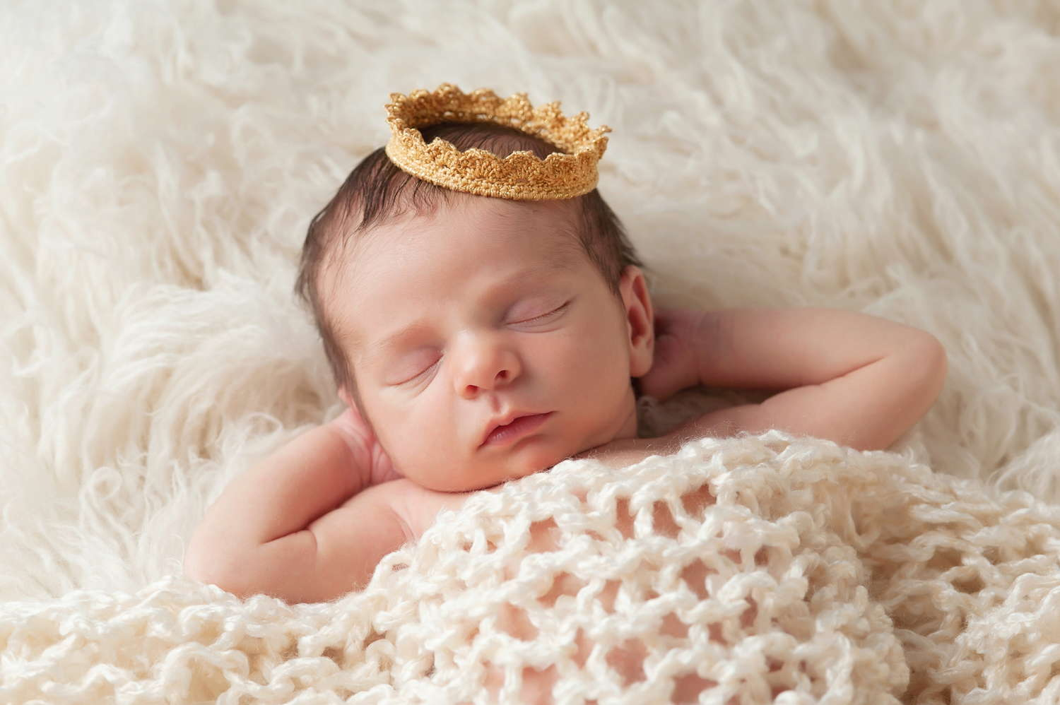 baby with a toy crown