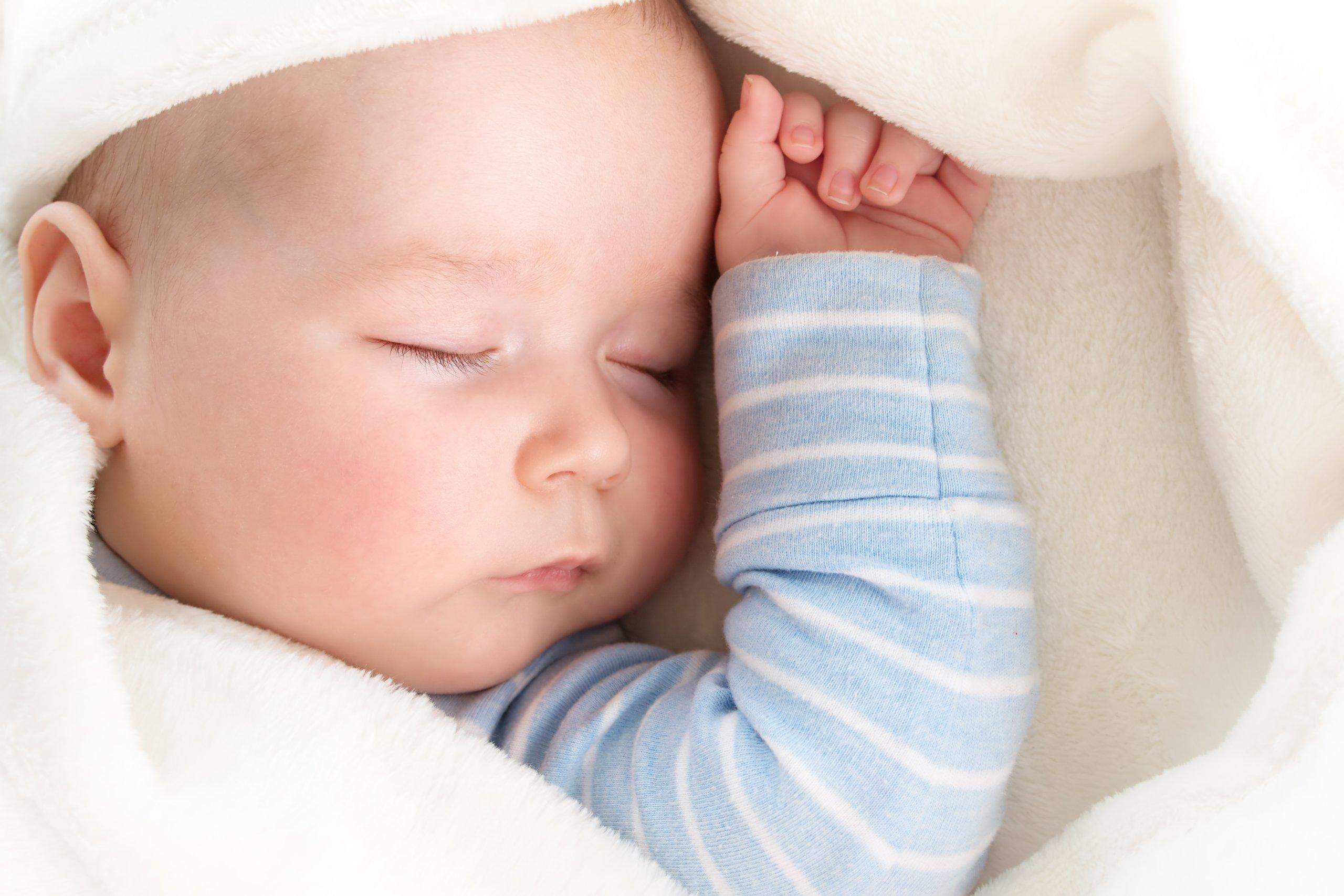 baby sleeping on back