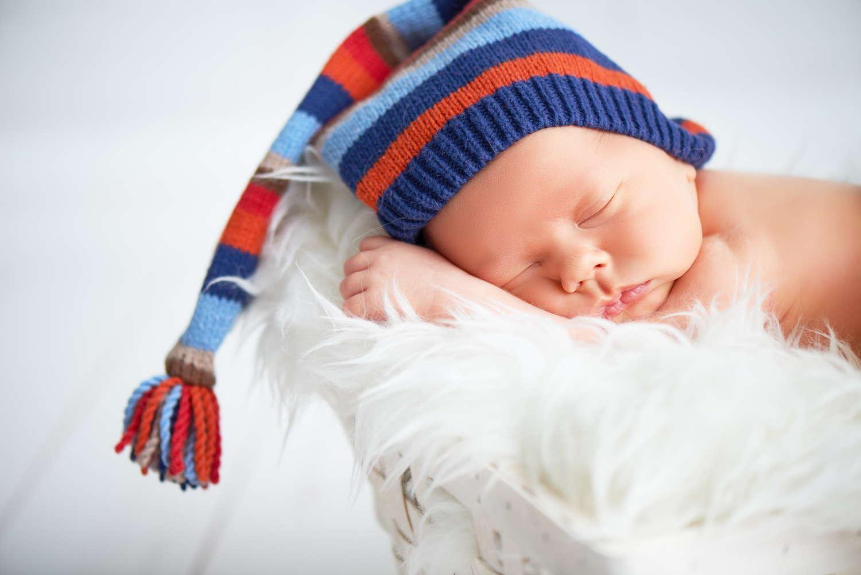 cute baby sleeping in a woolen hat