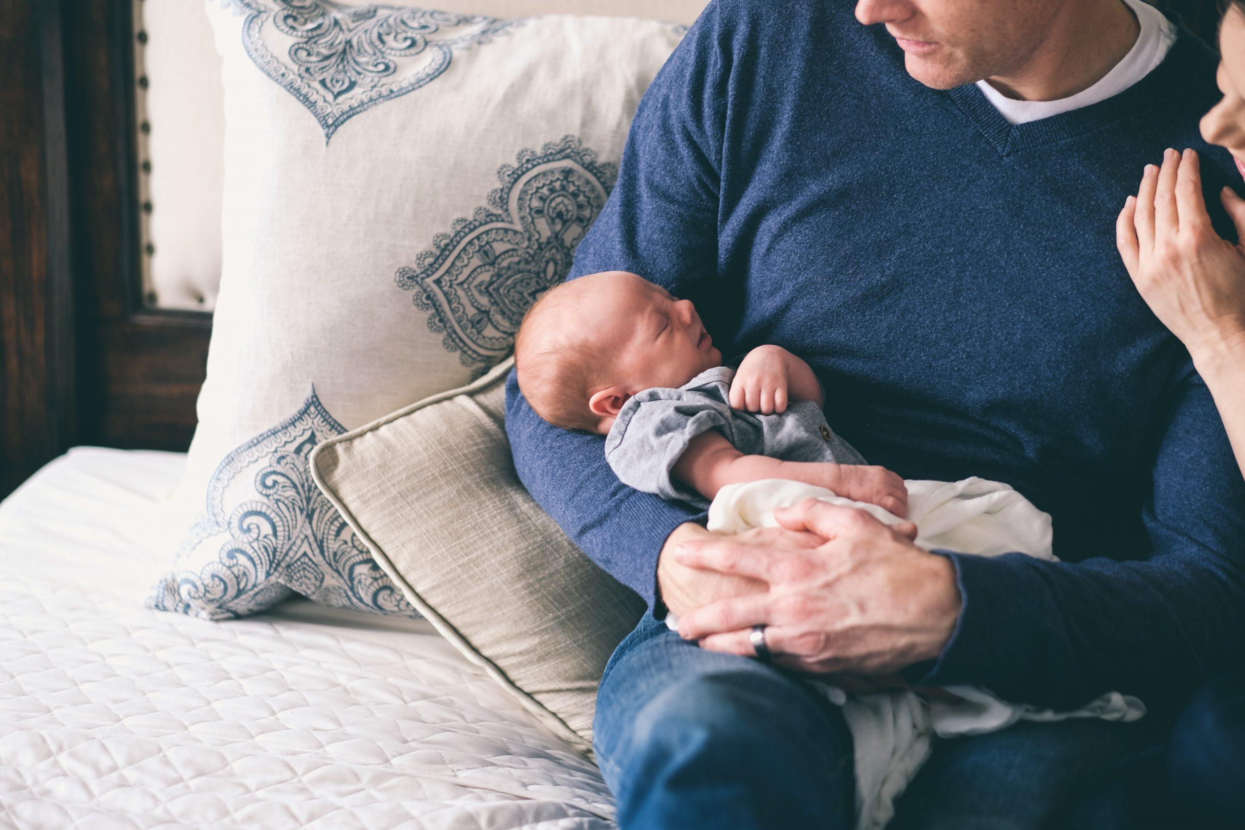 baby on parents lap